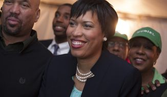 D.C. mayoral candidate and council member Muriel Bowser watches returns at her election night watch party in Washington, Tuesday, April 1, 2014. Bowser is the top challenger to Mayor Vincent Gray. (AP Photo/Cliff Owen)
