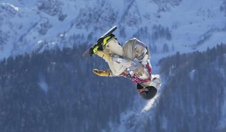 FILE - In this Feb. 8, 2014, file photo, United States' Sage Kotsenburg takes a jump during the men's snowboard slopestyle final at the Winter Olympics in Krasnaya Polyana, Russia. Kotsenburg walked off with honors for top male athlete at the U.S. Olympic Committee's inaugural Best of U.S. Awards.The USOC is handing out trophies in 10 categories Wednesday night, April 2, 2014, for the country's best performers at the Sochi Olympics and Paralympics, as voted on by fans. (AP Photo/Sergei Grits, File)