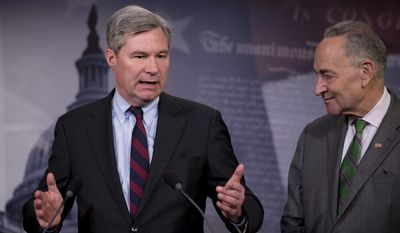 Sen. Sheldon Whitehouse, D-R.I. left, accompanied by Sen. Charles Schumer, D-N.Y., speaks to reporters on Capitol Hill in Washington, Wednesday, April 2, 2014, about the Supreme Court decision in the McCutcheon vs. FEC case, in which the Court struck down limits in federal law on the aggregate campaign contributions individual donors may make to candidates, political parties, and political action committees.  (AP Photo/Manuel Balce Ceneta)