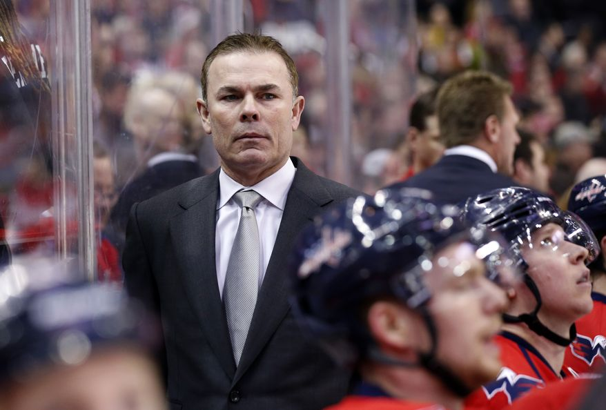 Washington Capitals head coach Adam Oates stands in the bench in the first period of an NHL hockey game against the Los Angeles Kings, Tuesday, March 25, 2014, in Washington. (AP Photo/Alex Brandon)