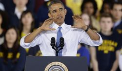 President Barack Obama speaks to students at the University of Michigan in Ann Arbor, Mich., Wednesday, April 2, 2014, about his proposal to raise the national minimum wage. (AP Photo/Carlos Osorio)