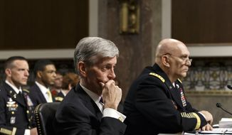 In this Thursday, April 3, 2014, file photo, Army Secretary John M. McHugh, left, and Army Chief of Staff Gen Raymond Odierno update members of the Senate Armed Services Committee about the deadly shooting rampage by a soldier at Fort Hood in Texas. (AP Photo/J. Scott Applewhite)