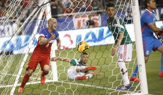 U.S. midfielder Michael Bradley, left, celebrates a goal against Mexico during the first half of an international friendly soccer match, Wednesday, April 2, 2014, in Glendale, Ariz. (AP Photo/The Arizona Republic, Michael Chow) MESA OUT  MARICOPA COUNTY OUT  MAGS OUT  NO SALES