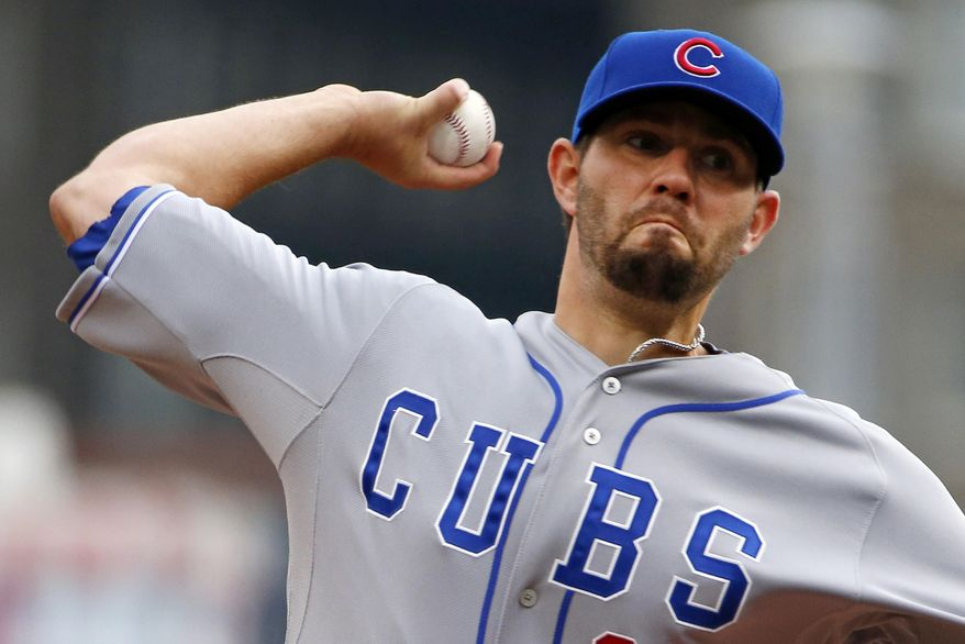 Chicago Cubs starting pitcher Jason Hammel delivers during the first inning of a baseball game against the Pittsburgh Pirates in Pittsburgh, Thursday, April 3, 2014. (AP Photo/Gene J. Puskar)