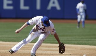 New York Mets second baseman Daniel Murphy commits a fielding error on a ball hit by Washington Nationals' Denard Span during the fourth inning of the baseball game at Citi Field, Thursday, April 3, 2014 in New York. (AP Photo/Seth Wenig)