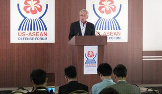 U.S. Defense Secretary Chuck Hagel speaks during a news conference at an Association of Southeast Asian Nations meeting in Honolulu on Thursday, April 3, 2014. (AP Photo/Oskar Garcia)