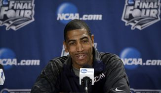 Connecticut head coach Kevin Ollie answers a question during a news conference for their NCAA Final Four tournament college basketball semifinal game Thursday, April 3, 2014, in Dallas. Connecticut plays Florida on Saturday, April 5, 2014. (AP Photo/David J. Phillip)