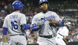 Los Angeles Dodgers' Hanley Ramirez is congratulated by Dodgers' Andre Ethier after scoring against the San Diego Padres in the first inning of an MLB National League baseball game Wednesday, April 2, 2014, in San Diego.  (AP Photo/Lenny Ignelzi)