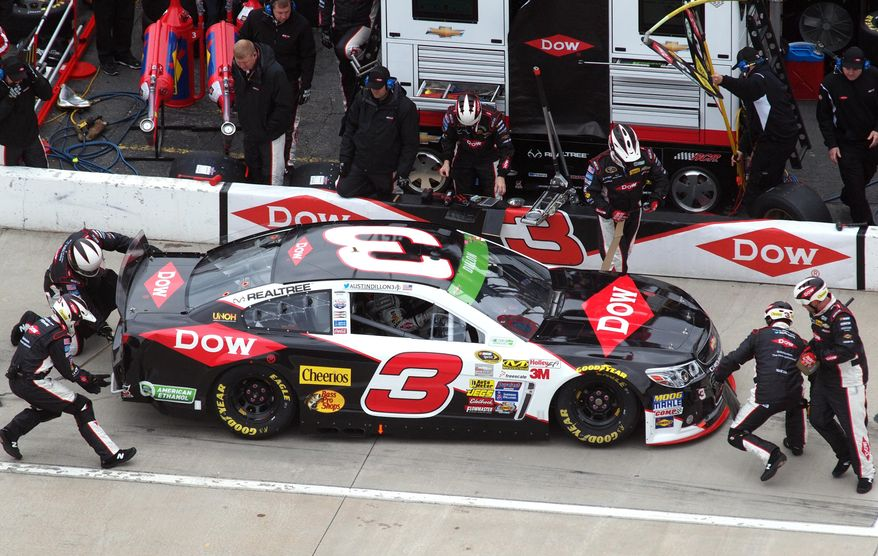 Austin Dillon (3) make a pit stop after being involved in a first lap accident during a NASCAR Sprint Cup Series auto race at Martinsville Speedway, Sunday, March 30, 2014, in Martinsville, Va. (AP Photo/Steve Shappard)