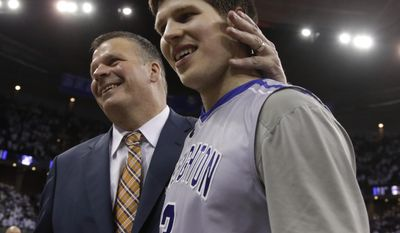 FILE - In this March 8, 2014 file photo, Creighton coach Greg McDermott congratulates his son, Doug McDermott (3), after scoring a career-high 45 points,  following an NCAA college basketball game against Providence in Omaha, Neb. McDermott, who finished his career at Creighton as college basketball's fifth-leading scorer, is a near-unanimous selection as The Associated Press' player of the year, Thursday, April 3, 2014. (AP Photo/Nati Harnik, File)