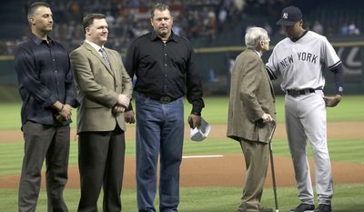 Former teammates Andy Pettitte, left, Mike Stanton and Roger Clemens along with Hall-of-Fame announcer Milo Hamilton line up to honor New York Yankees' Derek Jeter, right, before a baseball game against the Houston Astros Wednesday, April 2, 2014, in Houston. (AP Photo/Pat Sullivan)