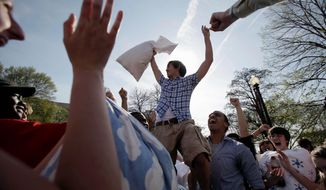 An man celebrates his victory over the competition during International Pillow Fight Day in DuPont Circle in the District in 2010. This year's Pillow Fight Day is Saturday. (Associated Press Photographs)