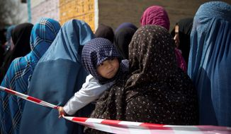 New Voices: Afghan women line up for voter registration cards this week. On Saturday, a segment of society that was oppressed under Taliban rule will help elect their country's next president. Cultural barriers will keep women from voting in some rural areas. (Associated Press photographs)