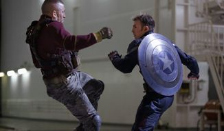"George St-Pierre, left, battles Chris Evans, who portrays Captain America, in a scene from ""Captain America: The Winter Soldier."" (marvel-Disney/Associated Press)"