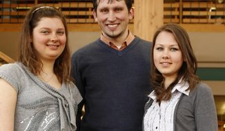 From left, Northwest College students from Ukraine, Inna Kucherenko, Iurii Kyrychenko and Yarsolava Krypak pose for a photo at Northwest College in Powell, Wyo., on March 27, 2014.  Events at home occupy the thoughts of three Northwest College students more than usual these days. For them, home is Ukraine, a place that, due to Russia's annexation of Crimea, has dominated world news in recent weeks.  (AP Photo/The Powell Tribune, Ilene Olson)