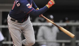 Minnesota Twins' Chris Colabello watches his 3-RBI double during the third inning of an baseball game against the Chicago White Sox in Chicago, Thursday, April 3, 2014. (AP Photo/Paul Beaty)