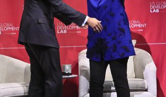 Former Secretary of State Hillary Rodham Clinton, right, and USAID Administrator Rajiv Shah prepare to embrace after she delivered the keynote address at the launch of the U.S. Global Development Lab, on Thursday, April 3, 2014, in New York. Clinton has helped launch a campaign aimed at ending extreme global poverty by 2030. The U.S. Agency for International Development is undertaking the anti-poverty effort with 32 partners from private industry and the academic world. Shah announced the campaign in New York on Thursday. (AP Photo/Bebeto Matthews)