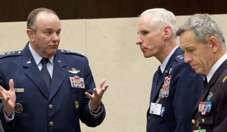 U.S. Air Force Gen. Philip Breedlove, left, the Supreme Allied Commander in Europe, speaks to colleagues during a meeting of the North Atlantic Council with Non-NATO ISAF Contributing Nations at NATO headquarters in Brussels on Wednesday, April 2, 2014. (AP Photo/Virginia Mayo)
