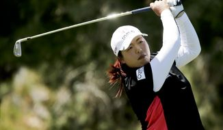 Shanshan Feng, of China, watches her tee shot on the 17th hole during the first round at the Kraft Nabisco Championship golf tournament on Thursday, April 3, 2014, in Rancho Mirage, Calif. (AP Photo/Chris Carlson)