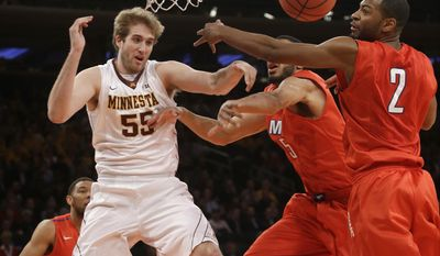 Minnesota's Elliott Eliason (55) passes the ball away from SMU's Shawn Williams (2) during the first half of an NCAA college basketball game in the final of the NIT on Thursday, April 3, 2014, in New York. (AP Photo/Frank Franklin II)