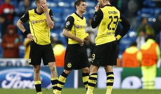 Dortmund's Kevin Grosskreutz, Jonas Hofmann and Julian Schieber, from left, ponder after the Champions League quarterfinal first leg soccer match between Real Madrid and Borussia Dortmund at the Santiago Bernabeu   stadium in Madrid, Spain, Wednesday, April 2, 2014. (AP Photo/Andres Kudacki)