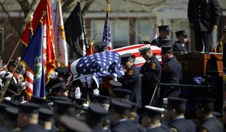 The casket containing the body of Boston firefighter Michael R. Kennedy is carried off his fire truck before his funeral outside Holy Name Church in Boston, Thursday, April 3, 2014. Kennedy and Boston Fire Lt. Edward J. Walsh were killed Wednesday, March 26, 2014 when they were trapped in the basement of a burning brownstone during a nine-alarm blaze.(AP Photo/Stephan Savoia)