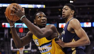 Denver Nuggets forward Kenneth Faried, left, looks to score over New Orleans Pelicans forward Anthony Davis, right, in the first half of an NBA basketball game on Wednesday, April 2, 2014, in Denver. (AP Photo/Chris Schneider)