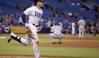 Tampa Bay Rays' Evan Longoria, left, heads to first base after hitting a three-run home run off Toronto Blue Jays pitcher Esmil Rogers (32) during the seventh inning of a baseball game in St. Petersburg, Fla., Thursday, April 3, 2014. (AP Photo/Phelan M. Ebenhack)