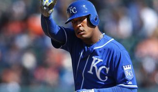 Kansas City Royals' Salvador Perez signals the bench after hitting a double against the Detroit Tigers in the eighth inning of a baseball game in Detroit, Wednesday, April 2, 2014. (AP Photo/Paul Sancya)
