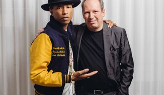 "In this Tuesday, March 25, 2014 photo, Pharrell, left, and Hans Zimmer pose at The Standard Hotel during press day for their collaboration on the soundtrack for ""The Amazing Spider-Man 2,"" in Los Angeles. The film releases May 2, 2014. (Photo by Casey Curry/Invision/AP)"