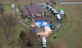 """In this aerial photo taken from WTHR Chopper 13, FBI agents work around the home of 91-year-old Donald Miller in Waldron, Ind. on Wednesday, April 2, 2014.  Authorities seized thousands of Native American, Russian, Chinese and other artifacts that have """"immeasurable"""" cultural value from Miller's private collection, the FBI said Wednesday. The items, which also came from Haiti, Australia, New Guinea and Peru, were collected by Miller over eight decades, FBI Special Agent Robert Jones said at a news conference. (AP Photo/The Indianapolis Star, Kelly Wilkinson)  NO SALES"""