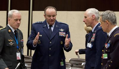 U.S. Air Force Gen. Philip Breedlove, the Supreme Allied Commander in Europe, second left, speaks to colleagues during a meeting of the North Atlantic Council with Non-NATO ISAF Contributing Nations at NATO headquarters in Brussels on Wednesday, April 2, 2014. (AP Photo/Virginia Mayo)