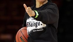 South Carolina head coach Dawn Staley directs her team during practice at the NCAA college basketball tournament in Stanford, Calif., Saturday, March 29, 2014.  South Carolina plays North Carolina in a regional semifinal on Sunday. (AP Photo/Marcio Jose Sanchez)