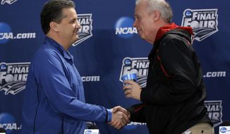 Wisconsin head coach Bo Ryan, right, and Kentucky head coach John Calipari shake hands after a joint news conference for their NCAA Final Four tournament college basketball semifinal game Thursday, April 3, 2014, in Dallas. Wisconsin plays Kentucky on Saturday, April 5, 2014. (AP Photo/David J. Phillip)