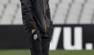 Juventus coach Antonio Conte walks during a training session in Lyon, central France, Wednesday, April 2, 2014. Juventus will face Lyon in a Europa League soccer match on Thursday. (AP Photo/Laurent Cipriani)