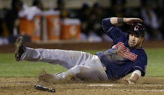 Cleveland Indians' Jason Kipnis scores on a groundout by Michael Brantley against the Oakland Athletics during the seventh inning of a baseball game in Oakland, Calif., Wednesday, April 2, 2014. (AP Photo/Jeff Chiu)