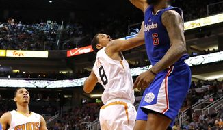 Los Angeles Clippers center DeAndre Jordan (6) dunks over Phoenix Suns forward Channing Frye (8) during the first half of an NBA basketball game on Wednesday, April 2, 2014, in Phoenix. (AP Photo/Matt York)