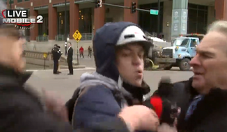 CBS Chicago reporter Jay Levine was ambushed by an anti-Obama protester during a live broadcast on Wednesday. (CBS Chicago via Mediaite)