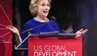 Former Secretary of State Hillary Rodham Clinton speaks as she delivers the keynote address at the launch of the U.S. Global Development Lab, an initiative of the U.S. Agency for International Development (USAID), on Thursday April 3, 2014 in New York.  Congress and USAID are headed for a showdown over the Obama administration's creation of a Cuban Twitter communications network to undermine the communist government in Cuba.  USAID Administrator Rajiv Shah is expected to testify on Tuesday before the Senate Appropriations State Department and foreign operations subcommittee.  (AP Photo/Bebeto Matthews)