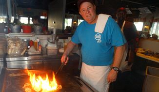 FILE - In this June 23, 2006 file photo, Uncle Bubba's Oyster House chef and owner Bubba Hiers, who is also Paula Deen's brother, grills oysters at the Savannah, Ga. restaurant. The wildly popular Georgia restaurant at the center of a lawsuit that left the reputation of famed Southern celebrity cook Paula Deen in shambles has reportedly closed. The Savannah Morning News and WSAV television both reported Thursday April 3, 2014 that Uncle Bubba's Seafood & Oyster House announced the closure on its Facebook page.  (AP Photo/Stephen Morton, File)