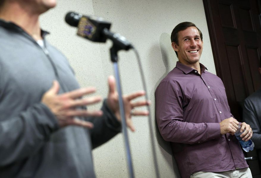 Baltimore Ravens tight end Owen Daniels laughs before being introduced by head coach John Harbaugh during an NFL football news conference, Friday, April 4, 2014, at the team's practice facility in Owings Mills, Md. Daniels, a former member of Houston Texans, joins his former head coach, Gary Kubiak, who is now Baltimore's offensive coordinator. (AP Photo/Patrick Semansky)