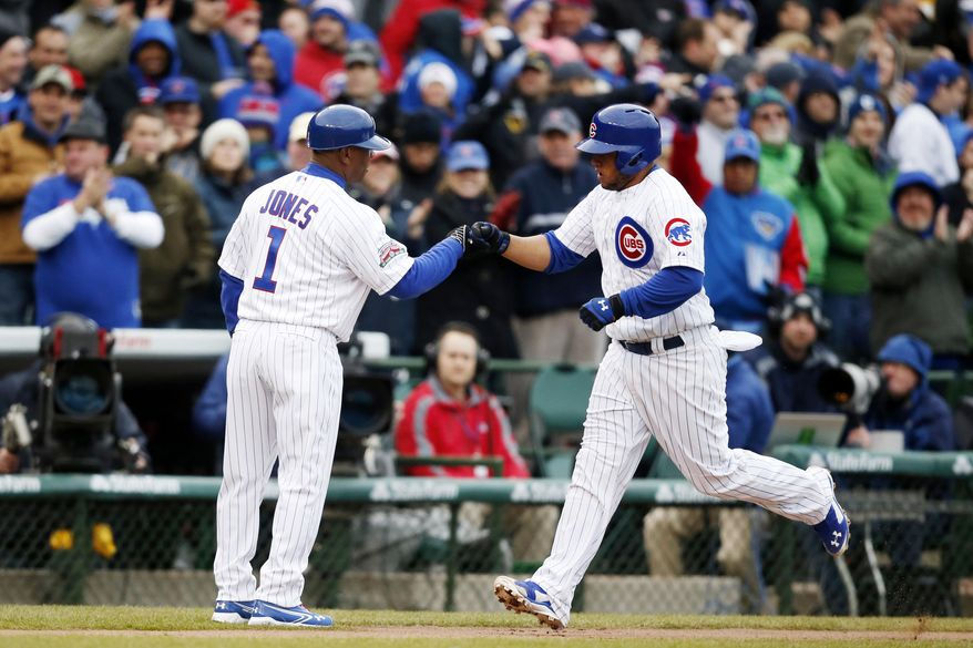 Chicago Cubs Welington Castillo, right, celebrates with third base coach Gary Jones after he hit a home run against the Philadelphia Phillies during the second inning of a baseball game on Friday, April 4, 2014, in Chicago. (AP Photo/Andrew A. Nelles)