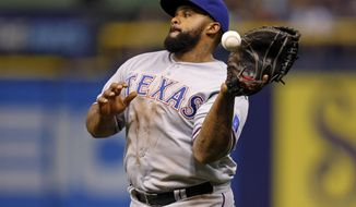 Texas Rangers first baseman Prince Fielder drops a foul ball hit by Tampa Bay Rays' Brandon Guyer during the fifth inning of a baseball game Friday, April 4, 2014, in St. Petersburg, Fla. (AP Photo/Mike Carlson)