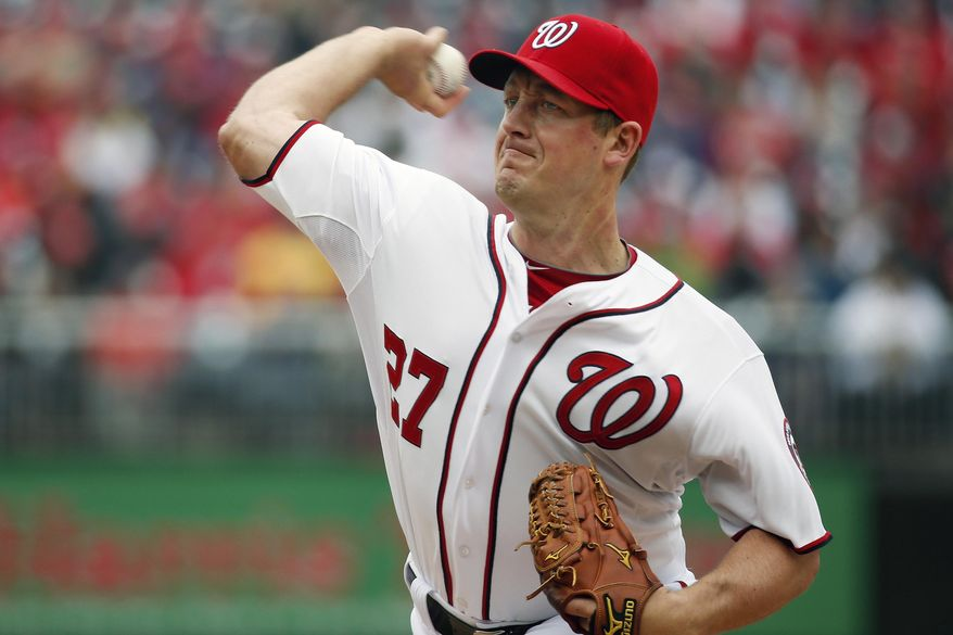 Washington Nationals starting pitcher Jordan Zimmermann throws in the third inning of a baseball home opener against the Atlanta Braves at Nationals Park, Friday, April 4, 2014, in Washington. (AP Photo/Alex Brandon)