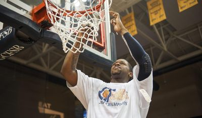 Murray State's Dexter Fields cuts down the first piece of net after an NCAA college basketball game against Yale for the CollegeInsider.com tournament championship, Thursday, April 4, 2014, in Murray, Ky. Murray State won 65-57. (AP Photo/The Ledger, Kyser Lough)