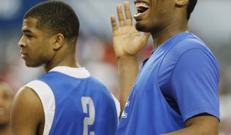 Kentucky guard Aaron Harrison, left and center Dakari Johnson react during practice for their NCAA Final Four tournament college basketball semifinal game Friday, April 4, 2014, in Dallas. Kentucky plays Wisconsin on Saturday, April 5, 2014. (AP Photo/Charlie Neibergall)