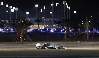 Mercedes driver Nico Rosberg of Germany steers his car during the second free practice ahead of the Bahrain Formula One Grand Prix at the Formula One Bahrain International Circuit in Sakhir, Bahrain, Friday, April 4, 2014. (AP Photo/Hassan Ammar)