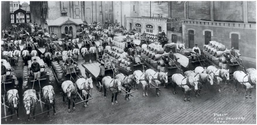 This image provided by the Pabst Mansion museum shows beer wagons and horse teams lined up to carry one day's delivery of beer for Milwaukee establishments in 1900. A small group of Milwaukee residents wants to revive the city's beer brewing tradition by buying Pabst Brewing Co. from a California executive in hopes of returning the brand's headquarters to its birthplace.  (AP Photo/Pabst Mansion)