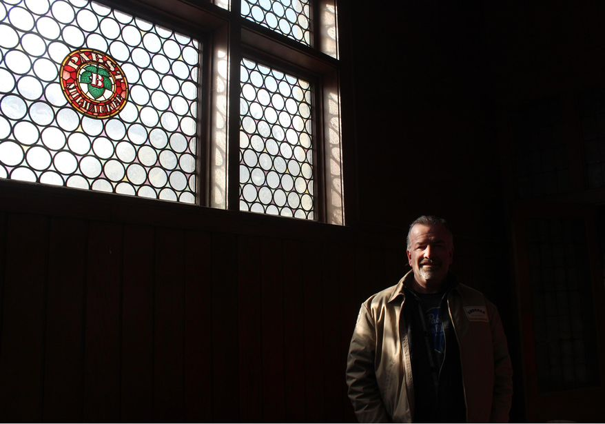 In this March 24, 2014 photo Jim Haertel stands in an upper floor of the former administrative building for Pabst brewery in Milwaukee. He bought that building and another one in 2001. He supports an effort to try to raise money to bring the company's headquarters back to Milwaukee.  (AP Photo/Carrie Antlfinger)