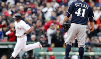 Milwaukee Brewers' Marco Estrada (41) watches as Boston Red Sox's Will Middlebrooks rounds third base on a solo home run in the third inning of a baseball game in Boston, Friday, April 4, 2014. (AP Photo/Michael Dwyer)